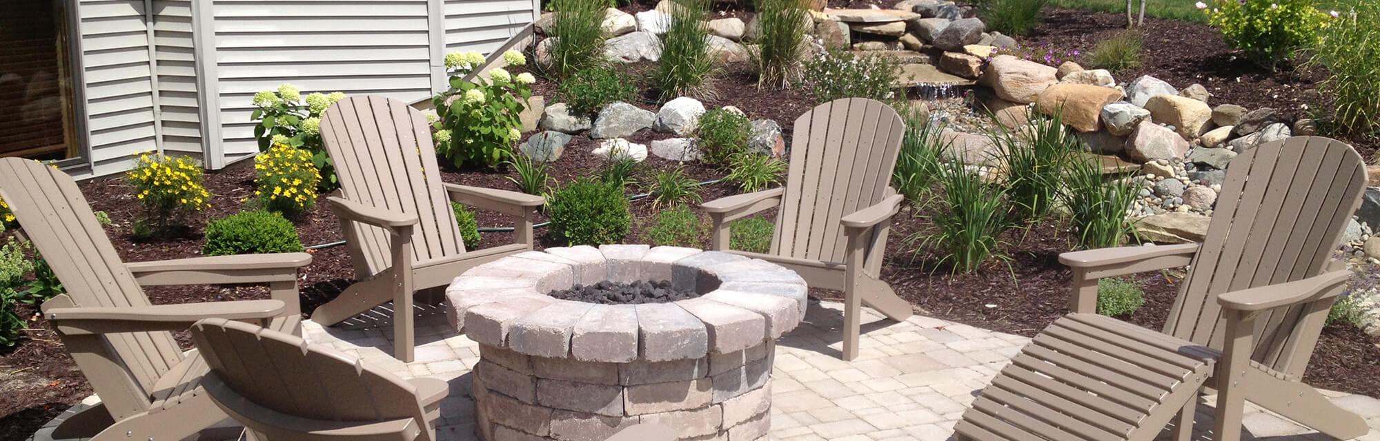 Banner of a beautiful outdoor patio with a fire pit.